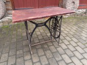 Table on cast iron stand