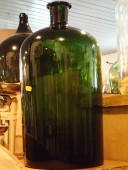 Antique large blown green bottle