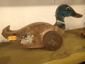 ANTIQUE DUCK ON WHEELS