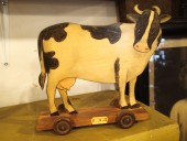 ANTIQUE COW ON WHEELS